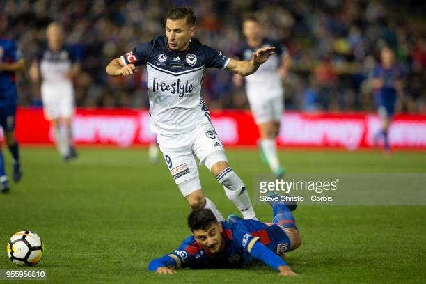 Kosta Barbarouses of Melbourne Victory tackles Jets John Koutroumbis during the 2018 ALeague Grand Final match between the Newcastle Jets and the...