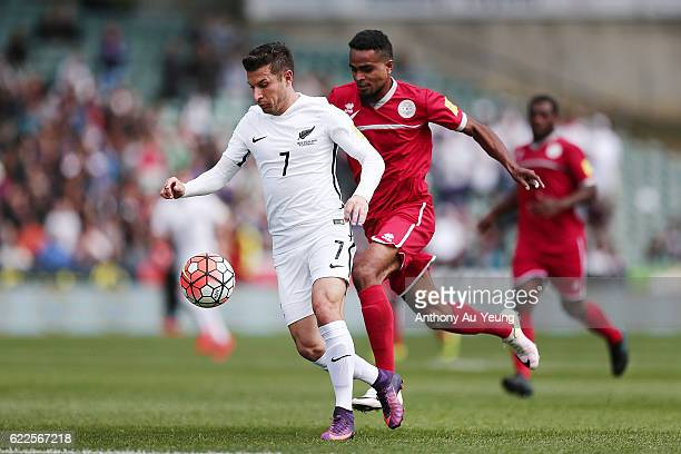 Kosta Barbarouses of New Zealand competes against Emile Bearune of New Caledonia during the 2018 FIFA World Cup Qualifier match between the New...