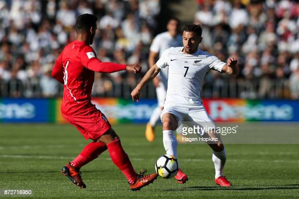 Kosta Barbarouses of New Zealand looks to evade Miguel Trauco of Peru during the 2018 FIFA World Cup Qualifier match between the New Zealand All...