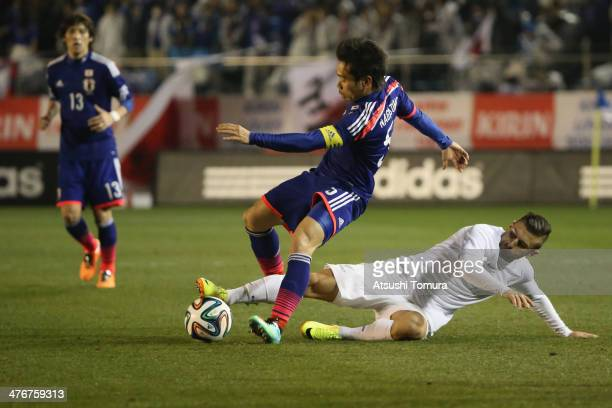 Kosta Barbarouses of New Zealand steals a ball from Yuto Nagatomo during the Kirin Challenge Cup international friendly match between Japan and New...