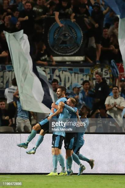 Kosta Barbarouses of Sydney celebrates scoring a goal with team mates during the round 12 ALeague match between Sydney FC and Melbourne City at...