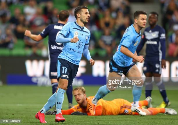 Kosta Barbarouses of Sydney FC celebrates after scoring a goal during the round 16 A-League match between the Melbourne Victory and Sydney FC at AAMI...