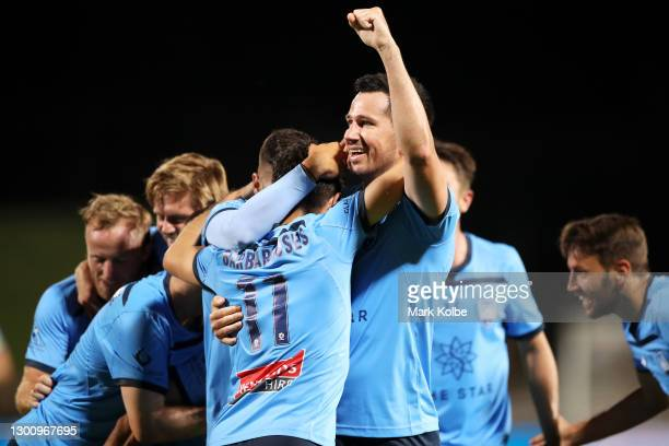 Kosta Barbarouses of Sydney FC celebrates with Ryan McGowan of Sydney FC and their team after scoring a goal during the A-League match between Sydney...