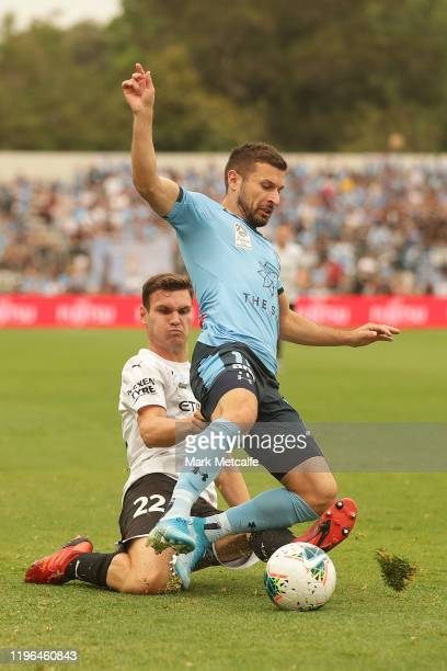 Kosta Barbarouses of Sydney is tackled by Curtis Good of Melbourne City during the round 12 A-League match between Sydney FC and Melbourne City at...