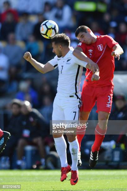 Kosta Barbarouses of the All Whites and Aldo Corzo of Peru compete for the ball during the 2018 FIFA World Cup Qualifier match between the New...