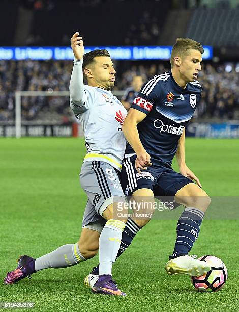 Kosta Barbarouses of the Phoenix and Mitchell Austin of the Victory compete for the ball during the round four ALeague match between the Melbourne...