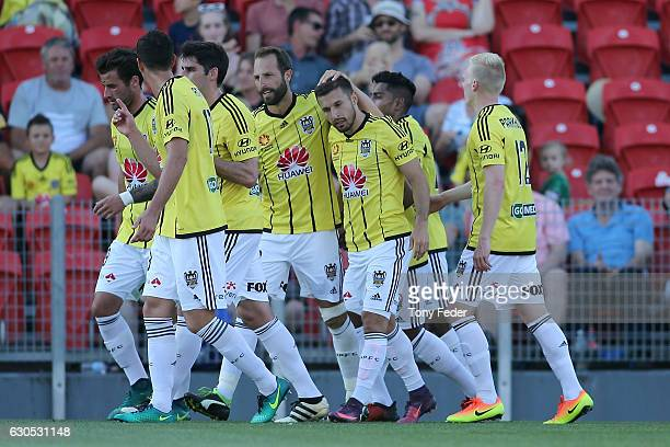 Kosta Barbarouses of the Phoenix celebrates a goal with team mates during the round 12 ALeague match between the Newcastle Jets and the Wellington...