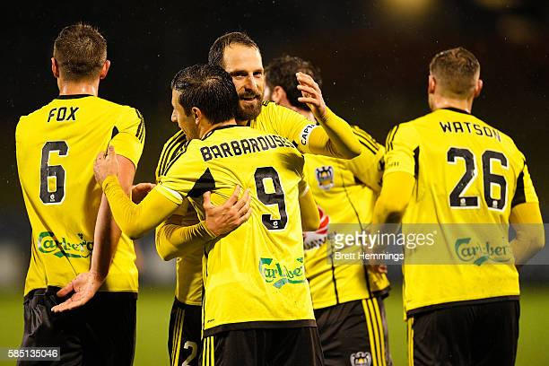 Kosta Barbarouses of the Phoenix celebrates scoring a goal with team mates during the FFA Cup Round of 32 match between the Western Sydney Wanderers...