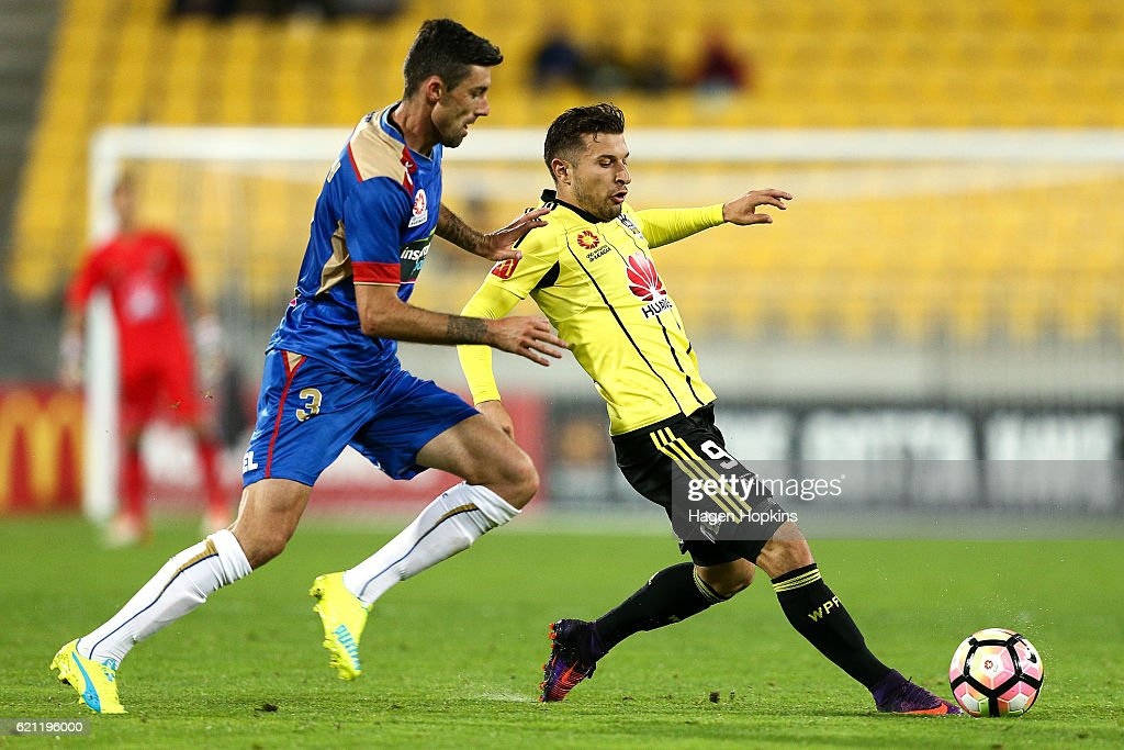 Kosta Barbarouses of the Phoenix is challenged by Jason Hoffman of the Jets during the round five A-League match between the Wellington Phoenix and the Newcastle Jets at Westpac Stadium on November 5, 2016 in Wellington, New Zealand.