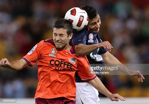 Kosta Barbarouses of the Roar and Adam D'Apuzzo of the Jets challenge for the ball during the round 10 A-League match between the Brisbane Roar and...