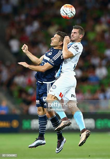 Kosta Barbarouses of the Victory and Benjamin Garuccio of the City compete to head the ball during the round 11 ALeague match between Melbourne City...