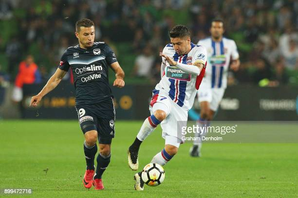 Kosta Barbarouses of the Victory and Dimitri Petratos of the Jets contest the ball during the round 13 ALeague match between the Melbourne Victory...