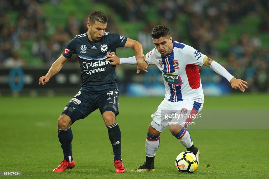Kosta Barbarouses of the Victory (L) and Dimitri Petratos of the Jets contest the ball during the round 13 A-League match between the Melbourne Victory and the Newcastle Jets at AAMI Park on December 29, 2017 in Melbourne, Australia.