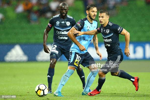 Kosta Barbarouses of the Victory and Milos Ninkovic of Sydney FC during the round 18 ALeague match between Melbourne Victory and Sydney FC at AAMI...