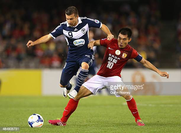 Kosta Barbarouses of the Victory and Zheng Zhi of Guangzhou compete for the ball during the AFC Asian Champions League match between the Melbourne...