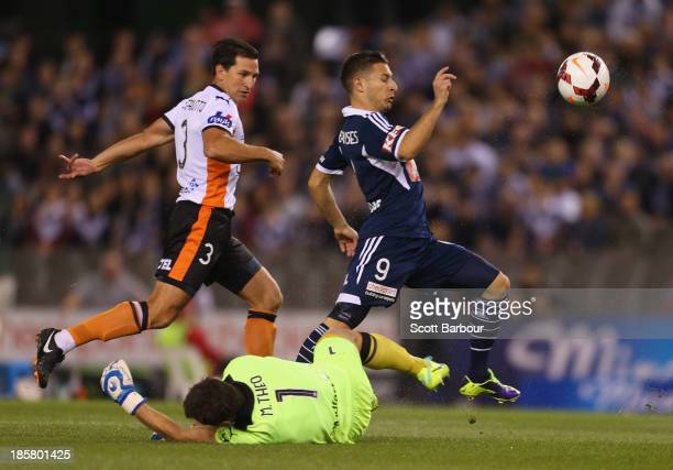 Kosta Barbarouses of the Victory attempts to score a goal as goalkeeper Michael Theo of the Roar makes a save during the round three ALeague match...