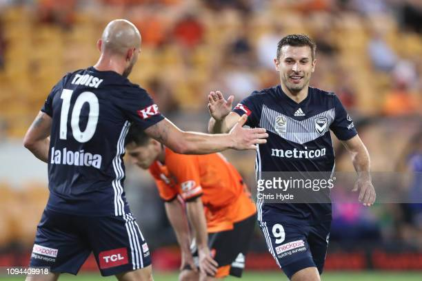Kosta Barbarouses of the Victory celebrates a goal during the round 15 ALeague match between the Brisbane Roar and the Melbourne Victory at Suncorp...