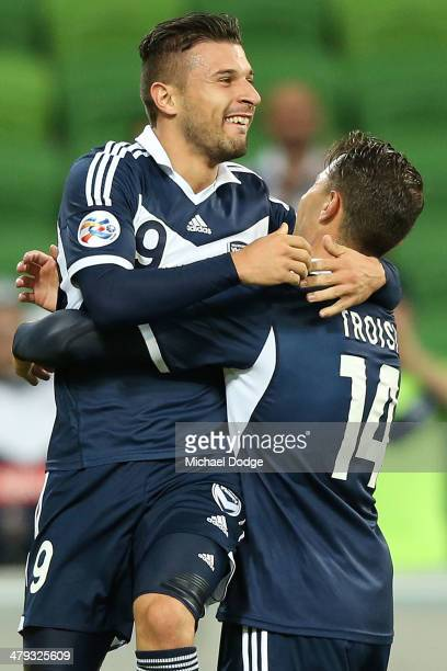 Kosta Barbarouses of the Victory celebrates his goal with James Troisi during the AFC Asian Champions League match between the Melbourne Victory and...