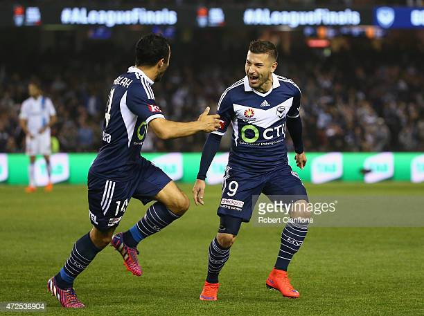 Kosta Barbarouses of the Victory celebrates with Fahid Ben Khalfallah after scoring a goal during the ALeague semi final match between Melbourne...