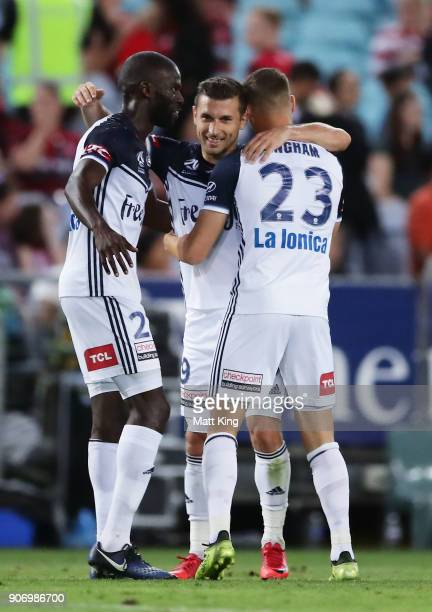 Kosta Barbarouses of the Victory celebrates with team mates after scoring his second goal during the round 17 ALeague match between the Western...