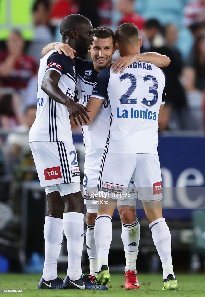 Kosta Barbarouses of the Victory celebrates with team mates after scoring his second goal during the round 17 A-League match between the Western Sydney Wanderers and the Melbourne Victory at ANZ Stadium on January 19, 2018 in Sydney, Australia.