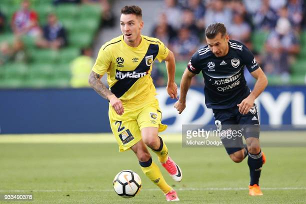 Kosta Barbarouses of the Victory chases Storm Roux of the Mariners during the round 23 ALeague match between the Melbourne Victory and the Central...