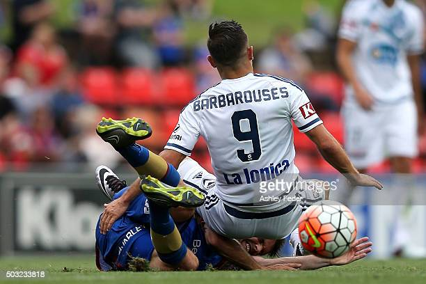 Kosta Barbarouses of the Victory collides with the Jets defence during the round 13 ALeague match between the Newcastle Jets and Melbourne Victory at...