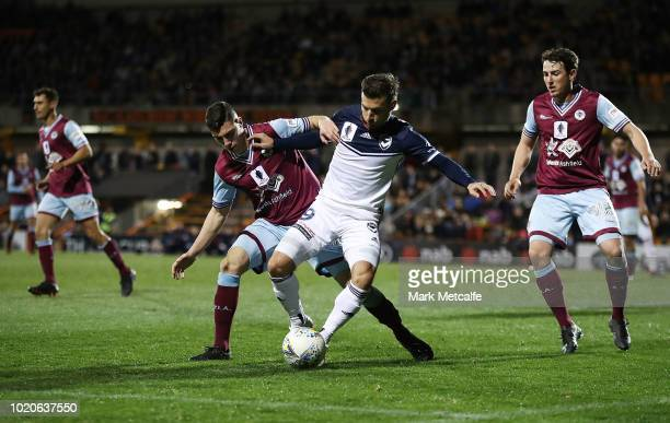 Kosta Barbarouses of the victory is challenged by Paul Galami of APIA Leichhardt Tigers during the FFA Cup round of 16 match between APIA Leichhardt...