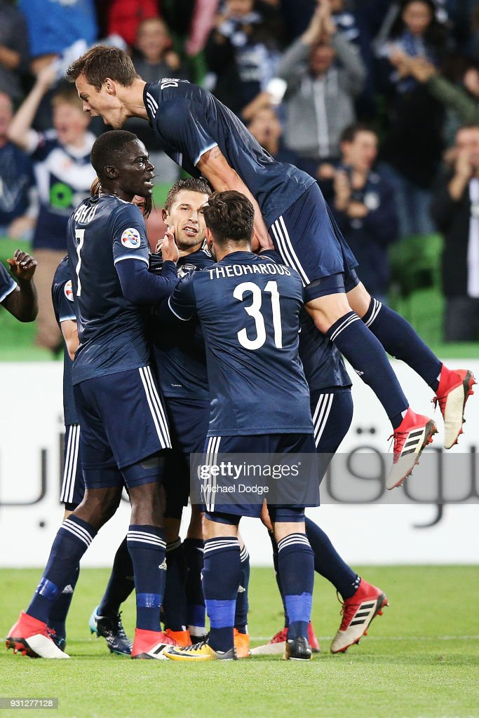 Kosta Barbarouses of the Victory is mobbed after scoring a goal in the dying stages during the AFC Asian Champions League match between the Melbourne Victory and Kawasaki Frontale at AAMI Park on March 13, 2018 in Melbourne, Australia.