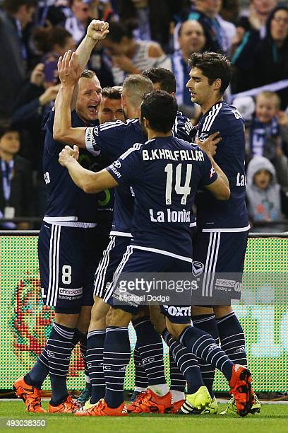 Kosta Barbarouses of the Victory is mobbed by Besart Berisha and Daniel GeorgievskIi after scoring a goal during the round two ALeague match between...