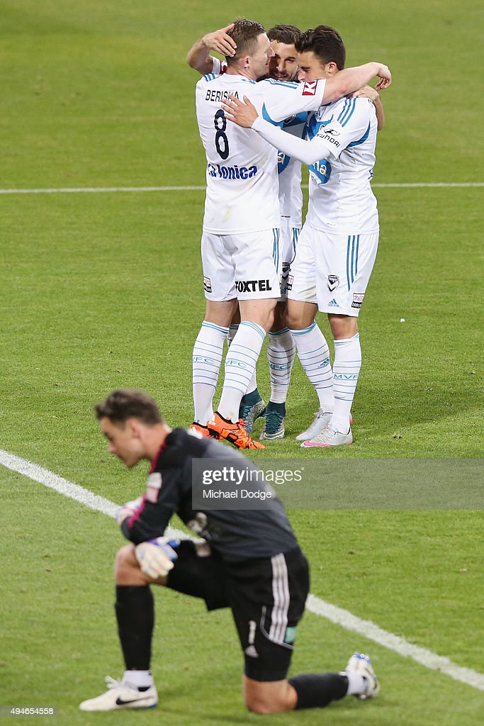 Kosta Barbarouses of the Victory is mobbed by Besart Berisha (L) and Jesse Makarounas (R) after kicking a goal during the FFA Cup Semi Final match between Hume City and Melbourne Victory at AAMI Park on October 28, 2015 in Melbourne, Australia.