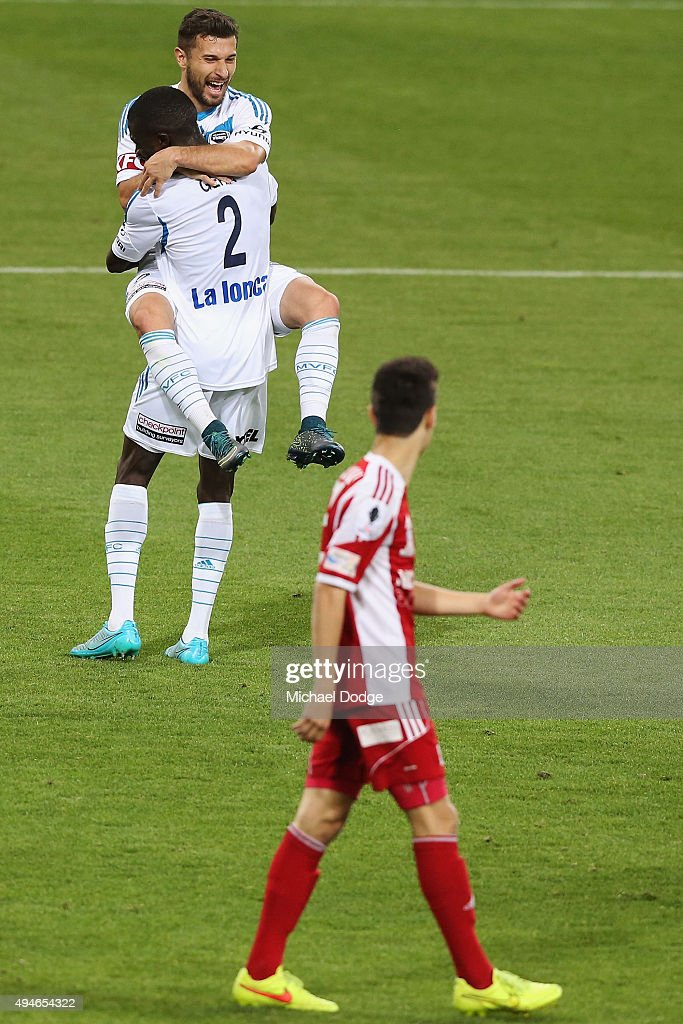 Kosta Barbarouses of the Victory jumps on Jason Geria after he kicked a goal during the FFA Cup Semi Final match between Hume City and Melbourne Victory at AAMI Park on October 28, 2015 in Melbourne, Australia.