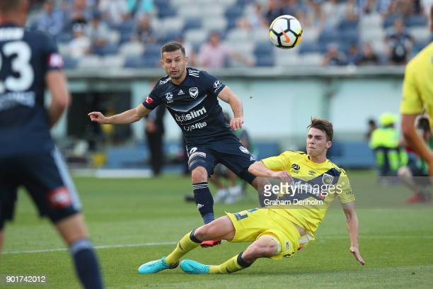 Kosta Barbarouses of the Victory shoots at goal during the round 14 ALeague match between the Melbourne Victory and the Central Coast Mariners at...