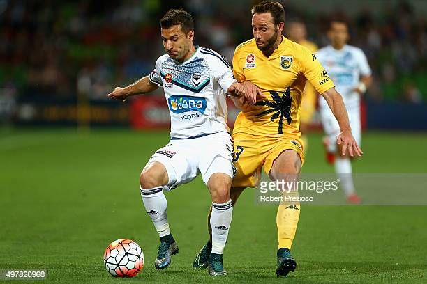 Kosta Barbarouses of Victory and Jushua Rose of Central Coast contest the ball during the round seven ALeague match between Melbourne Victory and...