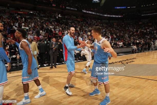 Kosta Koufos and Bogdan Bogdanovic of the Sacramento Kings celebrate a win against the Miami Heat on January 25 2018 at American Airlines Arena in...