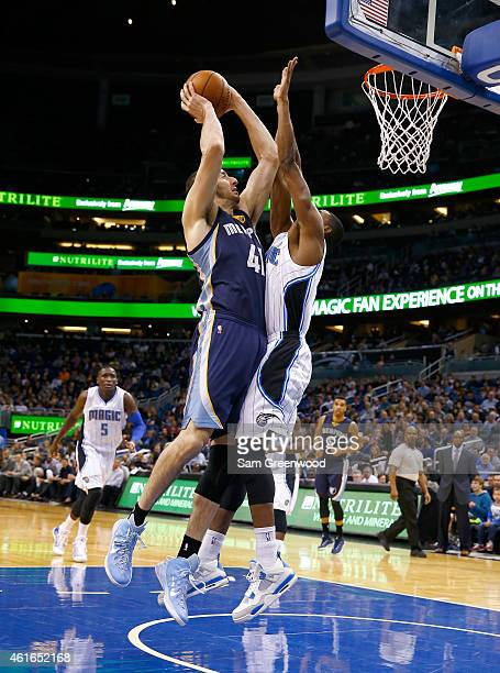 Kosta Koufos of the Memphis Grizzlies attempts a shot over Maurice Harkless of the Orlando Magic during the game at Amway Center on January 16 2015...