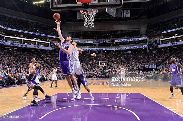 Kosta Koufos of the Sacramento Kings rebounds against Enes Kanter of the Oklahoma City Thunder on November 23 2016 at Golden 1 Center in Sacramento...