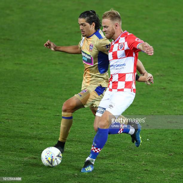 Kosta Petratos of the Jets and Justyn McKay of the Knights compete for the ball during the FFA Cup round of 32 match between Gold Coast Knights and...