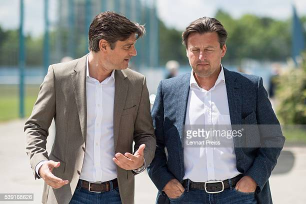 Kosta Runjaic new head coach of TSV 1860 Muenchen talks to Oliver Kreuzer manager of TSV 1860 Muenchen after a press conference on June 10 2016 in...
