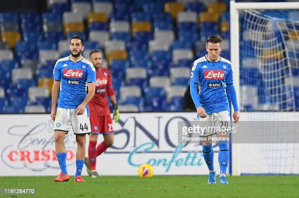 Kostantinos Manolas and Piotr Zielinski of SSC Napoli stand disappointed during the Serie A match between SSC Napoli and Bologna FC at Stadio San...