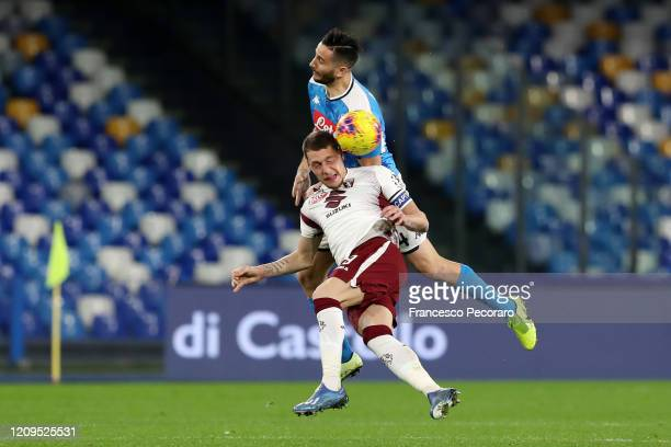 Kostantinos Manolas of SSC Napoli competes for the ball with Andrea Belotti of Torino FC during the Serie A match between SSC Napoli and Torino FC at...