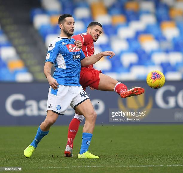 Kostantinos Manolas of SSC Napoli vies with Diego Falcinelli of Perugia during the Coppa Italia match between SSC Napoli and Perugia on January 14...