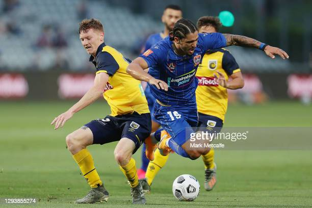 Kosta Petratos of the Jets is tackled by Kye Rowles of the Mariners during the A-League match between the Central Coast Mariners and the Newcastle...