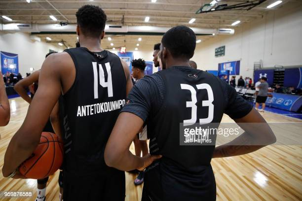Kostas Antetokounmpo and Shake Milton look on during the NBA Draft Combine Day 1 at the Quest Multisport Center on May 17 2018 in Chicago Illinois...