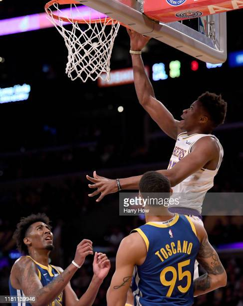 Kostas Antetokounmpo of the Los Angeles Lakers scores in front of Kavion Pippen and Juan ToscanoAnderson of the Golden State Warriors during a 10498...