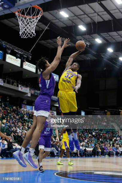 Kostas Antetokounmpo of the South Bay Lakers attempts a dunk over Moses Brown of the Texas Legends in the second quarter on January 04, 2020 at...