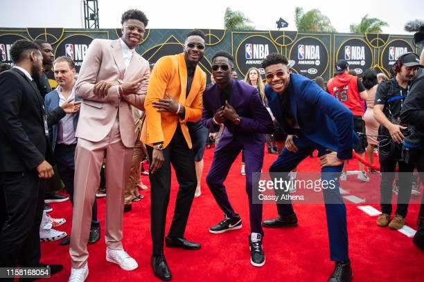 Kostas Antetokounmpo, Thanasis Antetokounmpo, Alexis Antetokounmpo and Giannis Antetokounmpo pose together on the red carpet at the NBA Awards at...
