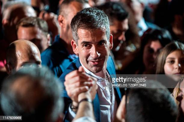 Kostas Bakoyannis the winner of the mayoral race in Athens celebrates with his supporters after his election victory on June 2 2019 Greece's...