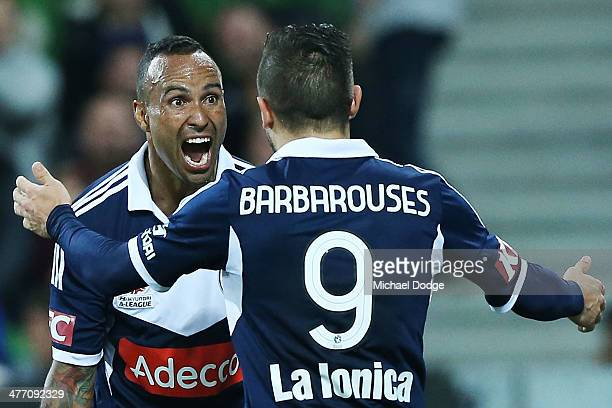 Kostas Barbarouses of the Victory celebrates his goal with Archie Thompson during the round 22 ALeague match between Melbourne Victory and the...
