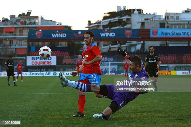 Kostas Chalkias of PAOK clears away the ball in front of Bosko Balaban of Panionios during the Super League match between FC Panionios and PAOK FC at...